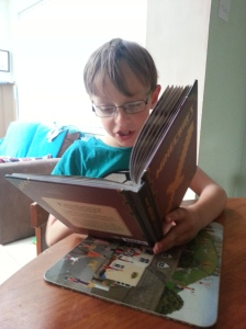 Son is reading a proper book... about his computer game